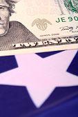 stock photo of american money  - american dollars on american flag - JPG