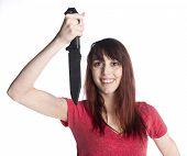 foto of shoulder-blade  - Close up Smiling Young Woman in red Shirt Holding a Knife Up While Looking at Camera - JPG
