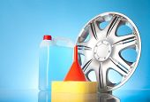 picture of alloy  - alloy wheel and car accessories on blue background - JPG