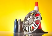 foto of rectifier  - traffic cone and car accessories on yellow background - JPG