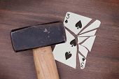 stock photo of spade  - Hammer with a broken card vintage look three of spades - JPG