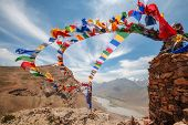 picture of mantra  - tibetan flags with mantra on sky background - JPG