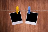 stock photo of clotheslines  - Blank instant photo hanging on the clothesline - JPG
