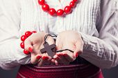 picture of rosary  - beautiful young woman wearing national ukrainian clothes and praying with rosary in hands  - JPG