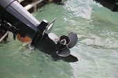 picture of outboard  - Motor boat is small craft equipped with an outboard motor but can be used oars - JPG