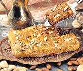 stock photo of halwa  - Closeup view of Badam Halwa garnish with almonds - JPG