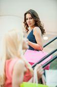 foto of escalator  - Angry young women taking escalator in shopping mall - JPG