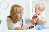 picture of heartbeat  - pediatrician examining heartbeat of kid boy with stethoscope - JPG
