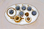 foto of serving tray  - Close up Six Cups of Turkish Coffee on White Tray Served on White Table in High Angle View - JPG