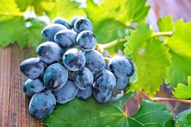 stock photo of grape  - fresh grape on the wooden table grape on a table - JPG