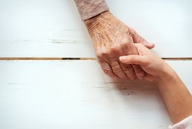 stock photo of grandmother  - Unrecognizable grandmother and her granddaughter holding hands - JPG