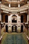 picture of hindu  - Adalaj Stepwell is a Hindu water building in the village of Adalaj close to Ahmedabad town in the Indian state of Gujarat - JPG