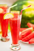 stock photo of watermelon slices  - Watermelon smoothie with lemon and watermelon slices - JPG