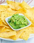 foto of nachos  - Cup with chunky guacamole served with nachos - JPG