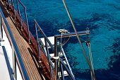 picture of crystal clear  - The crystal clear waters of the Mediterranean as seen from the deck of a yacht - JPG