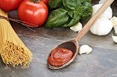 pic of basil leaves  - Spaghetti sauce with pasta basil leaves garlic and fresh tomatoes with extreme shallow depth of field - JPG