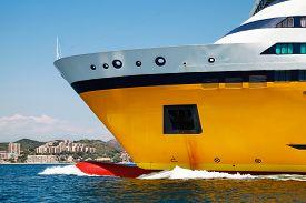 stock photo of passenger ship  - Big yellow passenger ferry ship goes on speed in the Mediterranean Sea - JPG