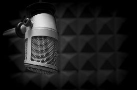 stock photo of studio  - professional microphone in a radio studio on a dark background - JPG