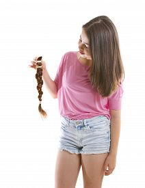 stock photo of generous  - Teenage girl in pink donating her hair to cancer patients  - JPG