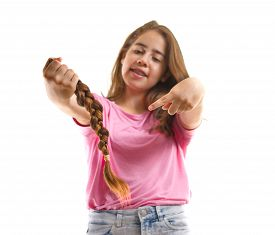 foto of generous  - Teenage girl in pink donating her hair to cancer patients  - JPG