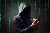 Computer hacker with mobile phone smartphone stealing data poster