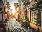 Old Town In Europe At Sunset With Retro Vintage Instagram Style Filter And Lens Flare Effect poster