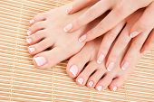 foto of french manicure  - care for beautiful woman legs - JPG