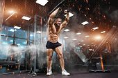 Strong Athletic Man Bodybuilderl Torso Showing Muscles In Gym poster