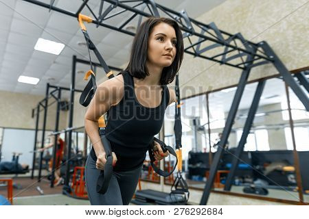 poster of Young Fitness Woman Doing Exercises Using The Trx System In The Gym. Sport, Fitness, Training, Peopl