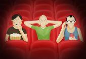 Three men in a cinema