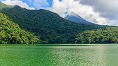 View Of Lake Bulusan In The Mountains With Green Rain Forest. Lake Hidden In The Jungle Mountains Ne poster