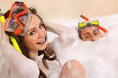 picture of turn-up  - A young beautiful couple is enjoying a bath in mask with snorkel - JPG