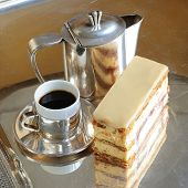 Mille-feuilles cake with a cup of coffee