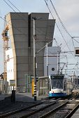 Tram with IJ tunnel towers in Amsterdam Holland