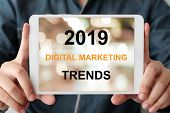 Man Hand Holding Digital Tablet With 2019 Digital Maerketing Trends On Screen Background, Digital Ma poster