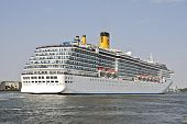 picture of ijs  - Huge cruise ship leaving Amsterdam harbor in the Netherlands - JPG