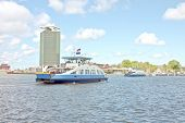 Ferries on the IJ in Amsterdam the Netherlands