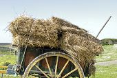 Old handcart with hay bales in the countryside