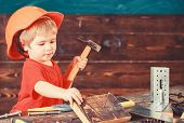 Toddler On Busy Face Plays With Hammer Tool At Home In Workshop. Child In Helmet Cute Playing As Bui poster