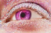 Macro Violet Or Pink Female Eye With Glitter Eyeshadow, Colorful Sparks, Crystals. Beauty Background poster