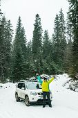 Man Standing In Front Of Suv Car Wheels In Chains. Snowed Forest. Journey poster