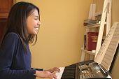 Cute Teen Playing Piano