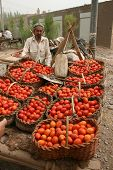 Chinese tomato seller in Kashgar,