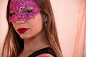 Face Portrait Of Beautiful Young Woman With Venetian Carnival Red Mask. Glamorous Girl With Perfect  poster