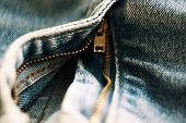 Open The Brass Zipper On Blue Jeans Made Of Coarse Cloth poster