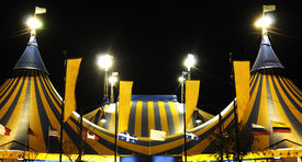 image of circus tent  - Yellow and Blue Circus tent at night - JPG
