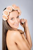 Beautiful smile with romantic flowers in her hair