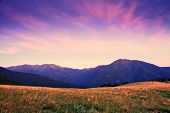 Mountain Dawn With Pink And Violet Clouds