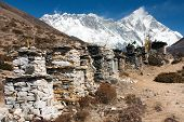 buddhist prayer walls or prayer stupas in nepal on the way to everest base camp