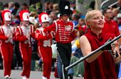Drum Majorette Leading Band In Red Uniforms
